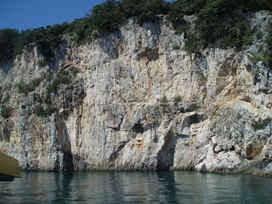 Vertical clifs of island Plavnik off Krk island